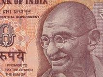 Retrato de Mahatma Gandhi en indio macro del billete de banco de 10 rupias, Indi Fotografía de archivo