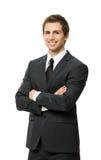 Retrato de medio cuerpo del hombre de negocios con los brazos cruzados Imagen de archivo libre de regalías