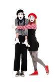 Retrato de mimes. hombre de abarcamiento de la mujer feliz Foto de archivo libre de regalías