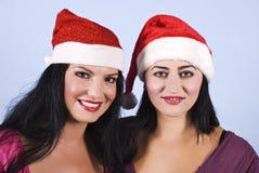 Retrato de mulheres da beleza com chapéu de Santa Imagem de Stock