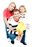 Retrato de padres felices con su hija Fotos de archivo libres de regalías