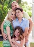 Retrato de pai loving que prende sua família Fotografia de Stock Royalty Free