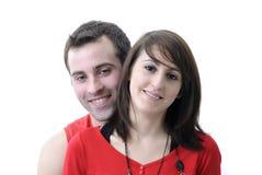 Retrato de pares jovenes en rojo Imágenes de archivo libres de regalías