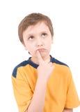 Retrato de pensamento do menino novo Foto de Stock Royalty Free
