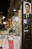 Retrato de presidente Assad en el souk de Damasco Imágenes de archivo libres de regalías
