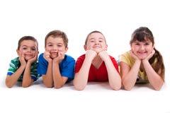 Retrato de quatro crianças fotografia de stock royalty free