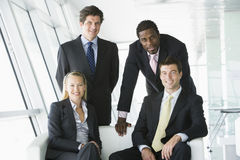 Retrato de quatro empresários no escritório Imagem de Stock Royalty Free