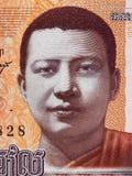 Retrato de rey Norodom Sihanouk de Camboya en el billete de banco mA de 100 rieles Fotos de archivo