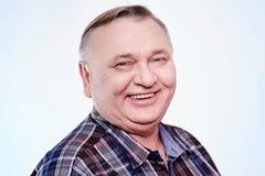 Retrato de riso do homem superior imagem de stock