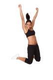 Retrato de salto Excited da jovem mulher Imagem de Stock Royalty Free