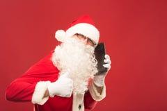 Retrato de Santa Claus feliz con un saco enorme Foto de archivo libre de regalías