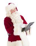 Retrato de Santa Claus Using Digital Tablet imagenes de archivo