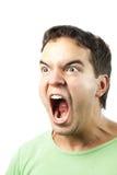 Retrato de sreaming enojado joven del hombre aislado Foto de archivo