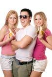 Retrato de três jovens alegres Fotos de Stock Royalty Free