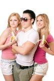 Retrato de três jovens felizes Imagens de Stock