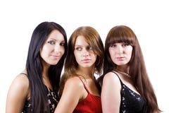 Retrato de três mulheres novas bonitas Fotografia de Stock Royalty Free
