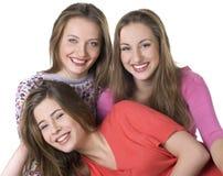 Retrato de tres muchachas felices imagenes de archivo