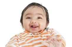 Retrato de um bebê de sorriso, isolado no branco Fotografia de Stock Royalty Free