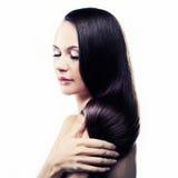 Retrato de um brunette novo Fotografia de Stock Royalty Free