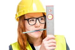 retrato de um contramestre concentrado com uma régua e um lápis dentro fotos de stock royalty free