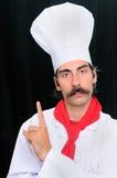 Retrato de um cozinheiro chefe sênior   Fotos de Stock
