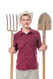 Retrato de um fazendeiro em um chapéu com um forcado e uma pá Imagem de Stock