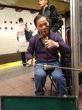 Retrato de um homem asiático no metro, New York Fotos de Stock Royalty Free