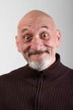 Retrato de um homem com expressões faciais engraçadas Fotos de Stock Royalty Free