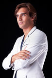 Retrato de um homem considerável com seu revestimento branco Fotografia de Stock