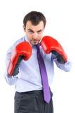 Retrato de um homem de negócio em luvas de encaixotamento vermelhas Imagens de Stock Royalty Free