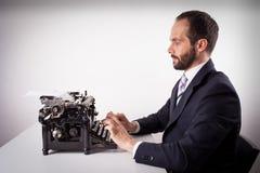 Retrato de um homem de negócio isolado no fundo branco. Fotografia de Stock Royalty Free
