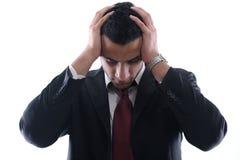 Retrato de um homem de negócio novo que olha comprimido Fotografia de Stock
