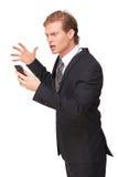 Homem de negócios forçado que olha o telefone fotos de stock royalty free