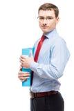Retrato de um homem de negócios nos vidros com um dobrador para papéis Imagens de Stock Royalty Free