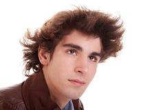 Retrato de um homem novo com cabelo no vento Foto de Stock Royalty Free