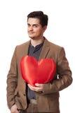 Retrato de um homem novo com forma do coração Fotografia de Stock Royalty Free