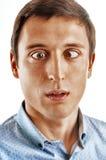 Retrato de um homem novo com olhos incomodados Imagem de Stock Royalty Free