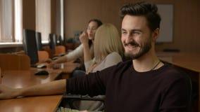 Retrato de um homem novo com um sorriso da barba vídeos de arquivo