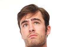 Retrato de um homem novo considerável que olha acima Imagem de Stock Royalty Free