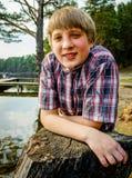 Retrato de um homem novo no parque Imagem de Stock Royalty Free
