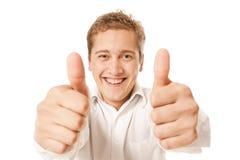 Retrato de um homem novo que mostra o polegar acima Fotos de Stock Royalty Free