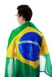 Retrato de um homem que guarda a bandeira brasileira Imagem de Stock Royalty Free