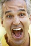 Retrato de um homem sênior com sua boca aberta Foto de Stock