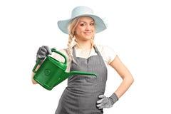 Retrato de um jardineiro com lata molhando Imagem de Stock Royalty Free