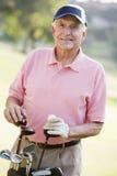 Retrato de um jogador de golfe masculino Imagens de Stock
