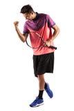 Retrato de um jogador de tênis masculino novo que comemora seu sucesso Fotografia de Stock Royalty Free
