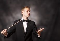 Retrato de um maestro de orquestra novo Fotografia de Stock