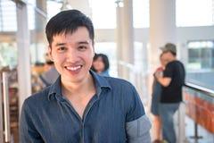 Retrato de um menino asiático novo e fresco no terreno Fotografia de Stock Royalty Free