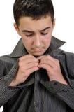 Menino do adolescente que veste-se acima fotografia de stock royalty free