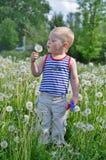 Retrato de um menino em um listrado Imagens de Stock Royalty Free